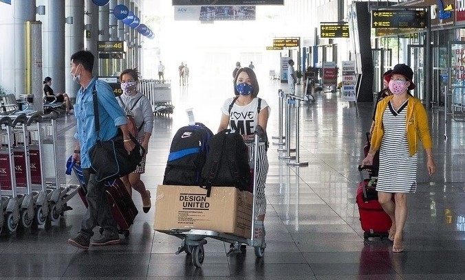 Tourists at Da Nang airport, central Vietnam, July 27, 2020. Photo: VnExpress / Khoi Tran.